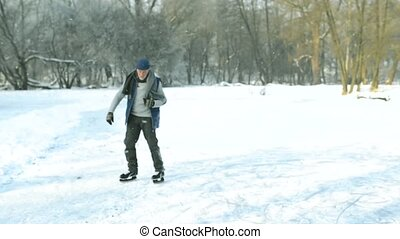 Senior man in sunny winter nature ice skating. - Handsome...