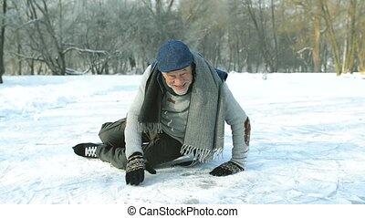 Senior man in sunny winter nature ice skating. - Handsome...