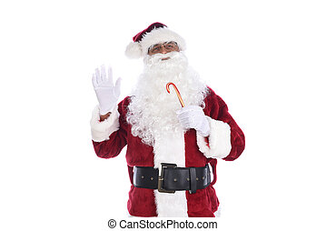 Senior man in traditional Santa Claus costume holding a candy cane in one hand and waving with the other. Isolated on white.