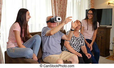 Senior man in virtual reality headset or 3d glasses having fun