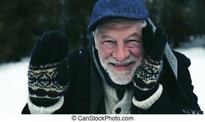 Senior man in warm clothes on a winter day. - Senior man in...