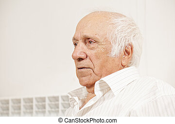 Senior man in white shirt