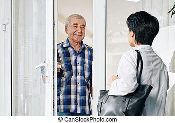 Senior man inviting caregiver