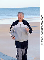 Senior man jogging on the beach