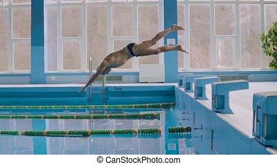 Senior man jumping in the swimming pool. - Senior man in an...