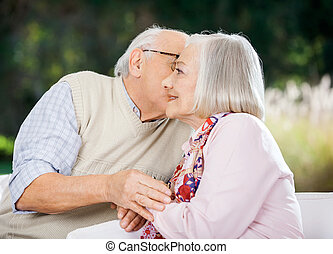 Senior Man Kissing Woman