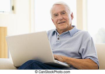 senior, man, laptop, computer, at home, sofa, browsing, ...
