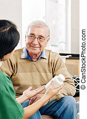 Senior man listening to nurse talking