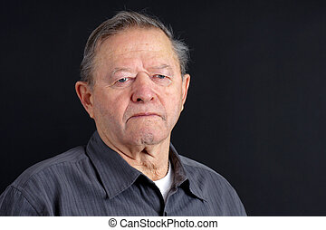 Senior man looking sad
