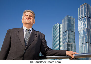 senior man near skyscrapers construction