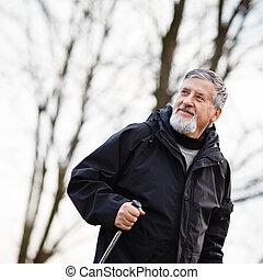 Senior man nordic walking