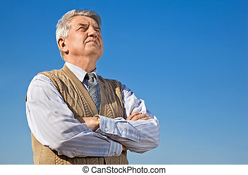 Senior man on background sky
