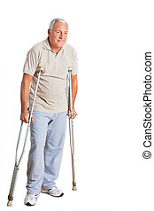 Senior Man On Crutches Looking Away