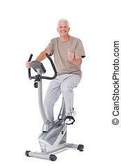 Senior man on exercise bike
