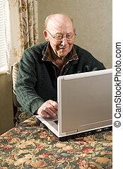 Senior man on laptop