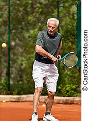 Senior man on tennis court