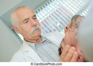 senior man physio with patient
