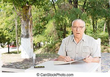 Senior man placing a food order
