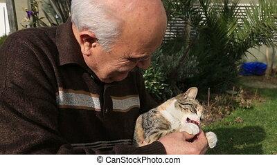 senior man playing cat