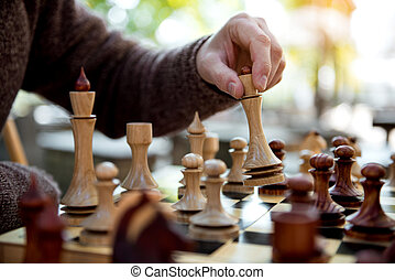 Senior man playing chess outdoor