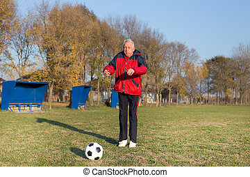 Senior man playing football