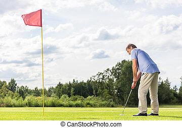 Senior man playing golf.