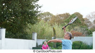 Senior man playing tennis in tennis court 4k - Excited...