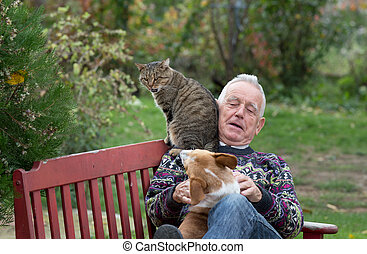 Senior man playing with pets