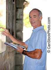 Senior man pointing to map