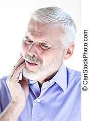 Senior man portrait frown toothache - caucasian senior man...