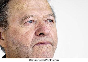Senior man portrait looking away