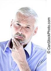 Senior man portrait puckering distrust - caucasian senior...