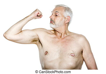 Senior man portrait showing biceps
