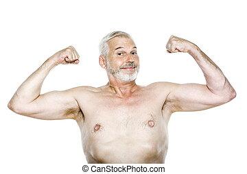 Senior man portrait showing biceps cheerful