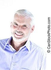 Senior man portrait toothy smile - caucasian senior man...