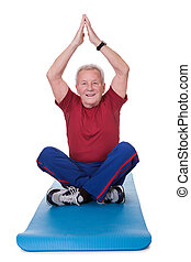 Senior Man Practicing Yoga