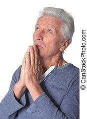 Senior man praying