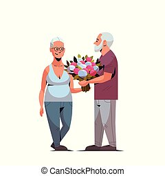 senior man presenting bouquet of flowers to elderly woman international happy womens day 8 march holiday concept couple in love white background full length