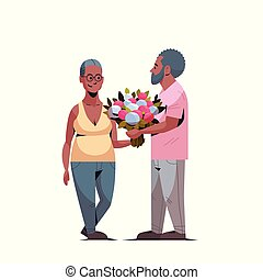 senior man presenting bouquet of flowers to elderly woman international happy womens day 8 march holiday concept african american couple in love white background full length