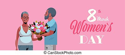 senior man presenting bouquet of flowers to elderly woman international happy womens day 8 march holiday concept african american couple in love horizontal portrait greeting card