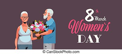 senior man presenting bouquet of flowers to elderly woman international happy womens day 8 march holiday concept couple in love horizontal portrait greeting card