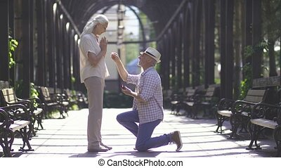 Senior man proposing his girlfriend with ring