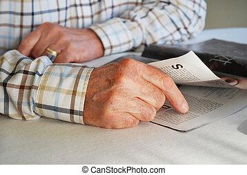 senior man reading a magazine