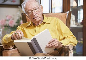 Senior man reading book