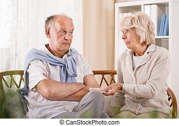 Senior man refusing taking medicament