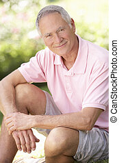 Senior man relaxing in a park