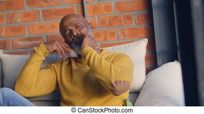 Senior man relaxing in living room 4k - Senior man relaxing ...