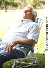 Senior Man Relaxing In Park