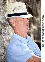 Senior man relaxing in the sunshine