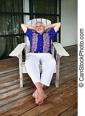 Senior man relaxing on a deck